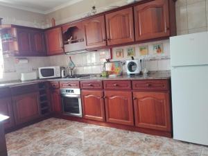 A kitchen or kitchenette at House of Ventura in Arco da Calheta