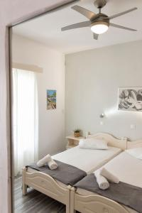 A bed or beds in a room at Apartments Tarsa