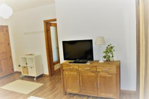 A television and/or entertainment center at Sandan Home