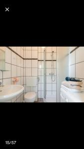 A bathroom at Studio apartmant Leona with parking place