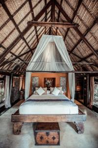A bed or beds in a room at Own Villa Bali