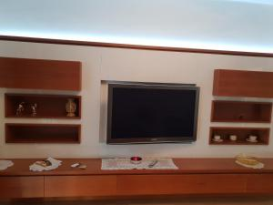A television and/or entertainment center at appartamento melotti - palazzo sky