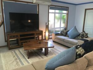 A television and/or entertainment center at Taj on Byrnes - Private Luxury Apartment Mareeba