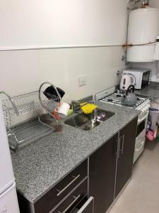 Una cocina o kitchenette en Santafe Departamentos
