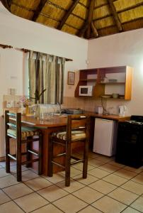 A kitchen or kitchenette at Orchards Farm Cottages