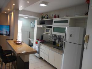 A kitchen or kitchenette at Caldas Novas - Prive das Thermas II