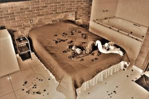 Cama ou camas em um quarto em Chales Fazenda Cantinho do Selado