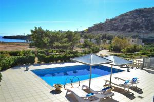 A view of the pool at Luxury Villa Melissa or nearby