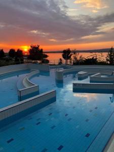 The swimming pool at or near Velence Wellness Apartman
