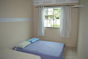 Cama o camas de una habitación en Mozamba Surf House
