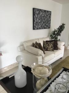 A seating area at Apartamento Acolhedor