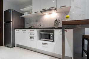A kitchen or kitchenette at Emerald Terrace By Rents In Phuket