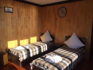 Кровать или кровати в номере Holiday homes Aliye Parusa