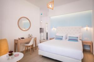 Ένα ή περισσότερα κρεβάτια σε δωμάτιο στο Hermes Beach Studios
