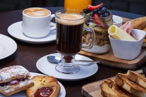 Breakfast options available to guests at Apart Hotel del Volcan