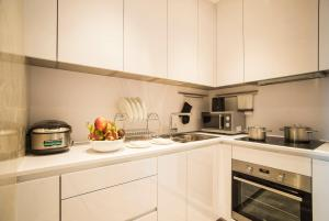 A kitchen or kitchenette at The Reverie Saigon Residential Suites