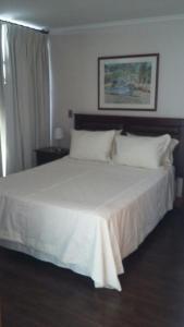 Cama o camas de una habitación en Austral Rentahome Américo Vespucio Norte