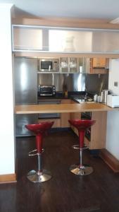 Una cocina o zona de cocina en Austral Rentahome Américo Vespucio Norte