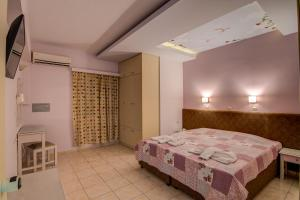 A bed or beds in a room at Alkionis Beach