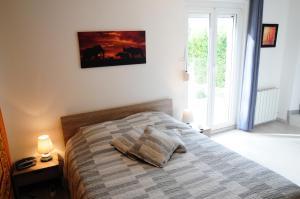 Un ou plusieurs lits dans un hébergement de l'établissement Chez Laurent Et Sandrine