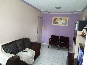 A seating area at Apartamento condomínio Jaçanã