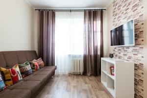A seating area at Comfortable Apartment at Novoslobodskaya