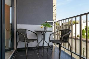 A balcony or terrace at Good Time Apartments Strzelecka II