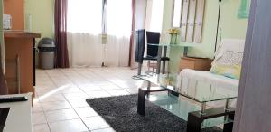 A television and/or entertainment center at flats-4u - Cosy, quite & clean apartments in the city ( Apt.4 )