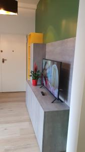 A television and/or entertainment center at SNC1018 MODERN BOUTIQUE APARTMENT