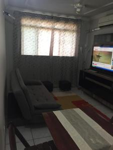 A seating area at Apartamento Mobiliado em Cuiabá