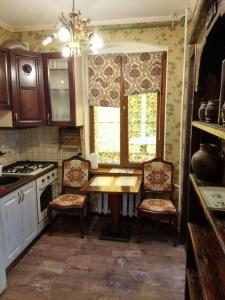 A kitchen or kitchenette at Apartments in the spirit of the old Königsberg
