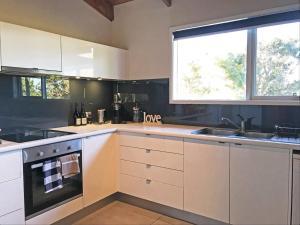 A kitchen or kitchenette at Sandy Point Luxury Beach House