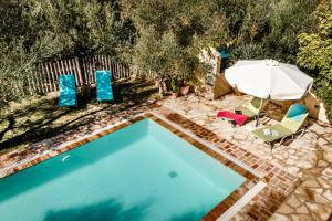 A view of the pool at Mastrogiannis villa Dafne or nearby