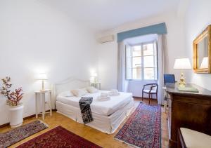 Letto o letti in una camera di Rent in Rome - Veneto 116