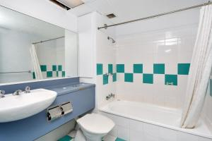 A bathroom at Sunshine Towers 407 - One Bedroom Studio Apartment
