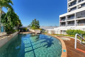 The swimming pool at or near Sunshine Towers 407 - One Bedroom Studio Apartment