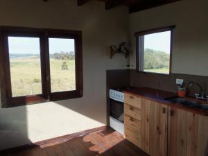 Una cocina o kitchenette en Cabaña con Vista al Mar