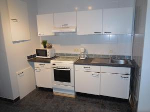 A kitchen or kitchenette at Brussels Central Flats