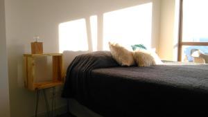 Una cama o camas en una habitación de El Descanso