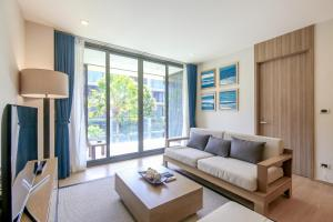 A seating area at Baan Mai Khao Beachfront [ Two-Bedroom Family Suite ]