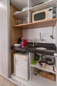 A kitchen or kitchenette at RAD2704 Wonderful oceanfront flat in Boa Viagem