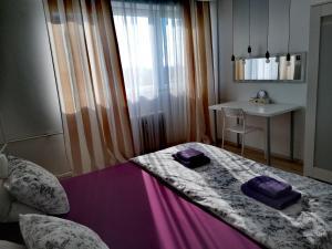 Posteľ alebo postele v izbe v ubytovaní Apartman LKM Zagreb