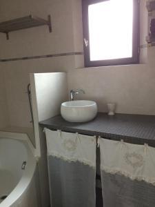 Salle de bains dans l'établissement Le Gîte du Château