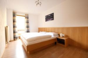 Ein Bett oder Betten in einem Zimmer der Unterkunft Edelberg Apartments