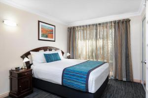A bed or beds in a room at Quest Yelverton Kalgoorlie