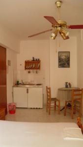 A kitchen or kitchenette at Machi's Guest House