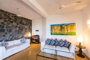 A seating area at Kottukal Beach House by Jetwing
