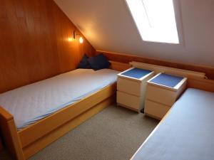 Ein Bett oder Betten in einem Zimmer der Unterkunft Appartement Kayser Sylt