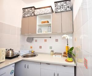 A kitchen or kitchenette at Sweet Story Central Apartment