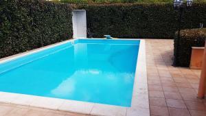 The swimming pool at or near Olgiata 84